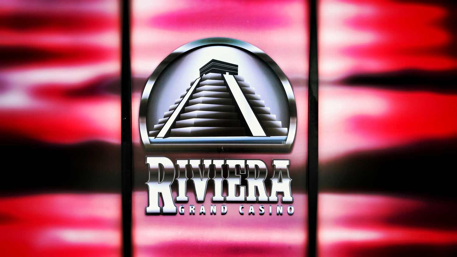 The Riviera Grand Casino logo on the side of the wall outside the entrance.