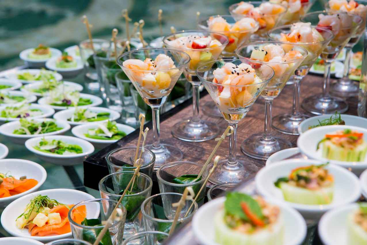 Several seafood cocktails and small salads waiting to be served to resort guests.