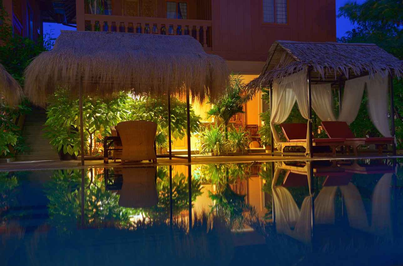 A private swimming pool at night.