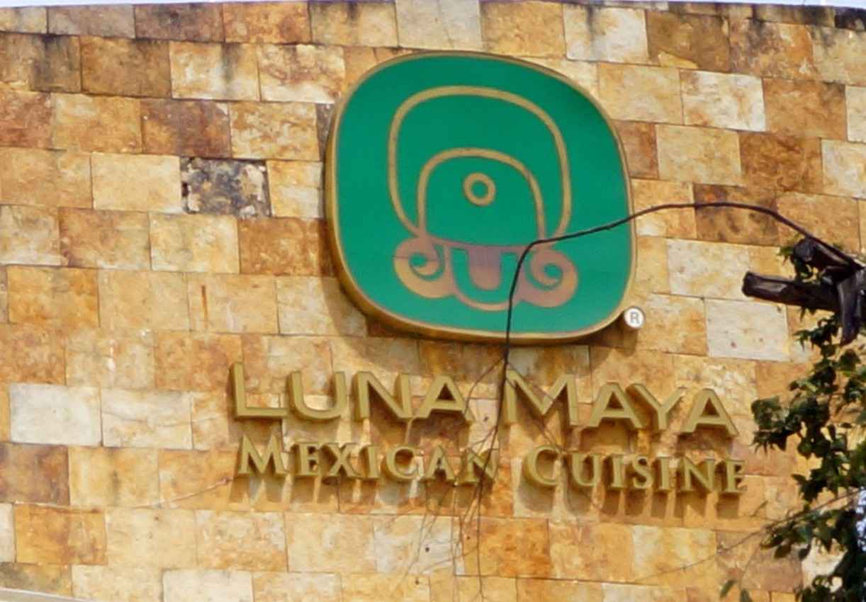 Luna Maya Mexican cuisine logo and sign on the outside of a building.