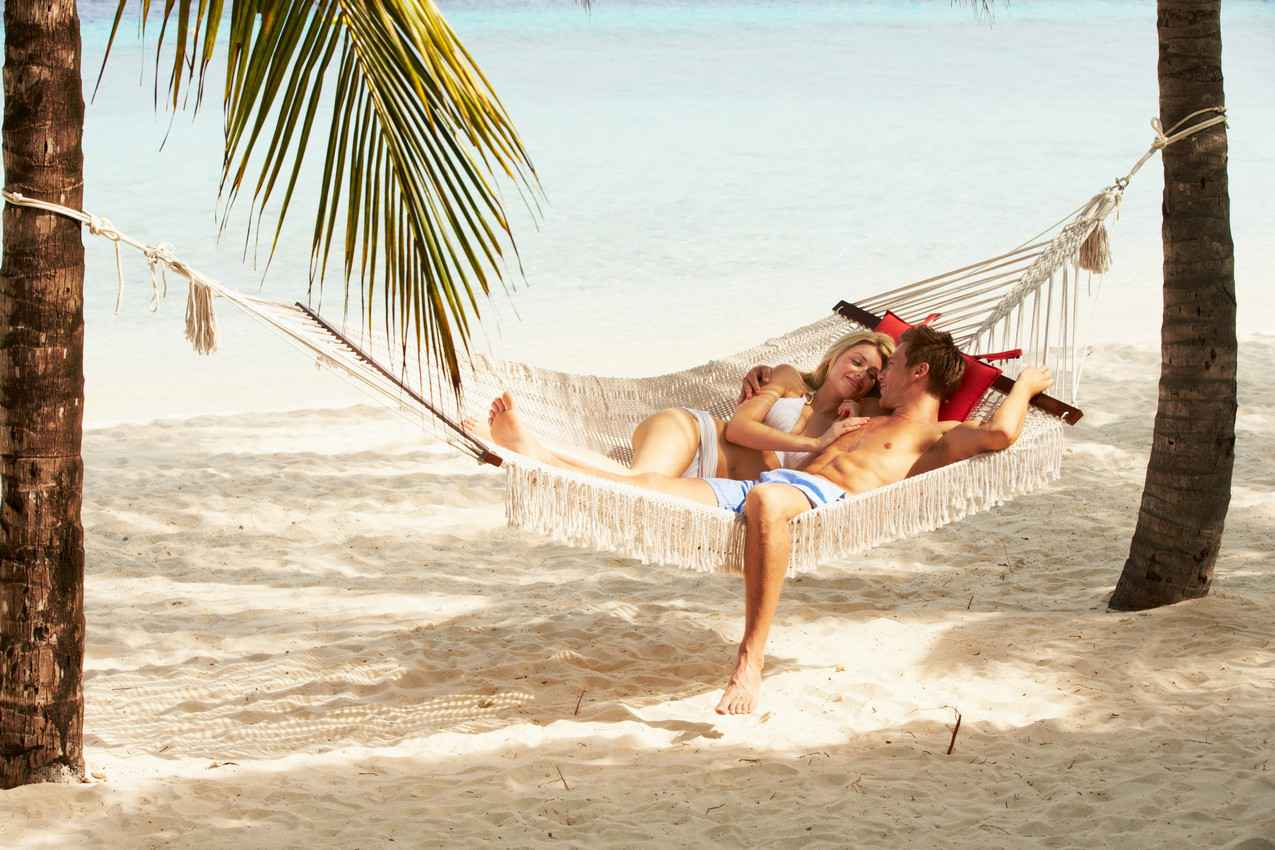 Living the easy life in a hammock on the beach.