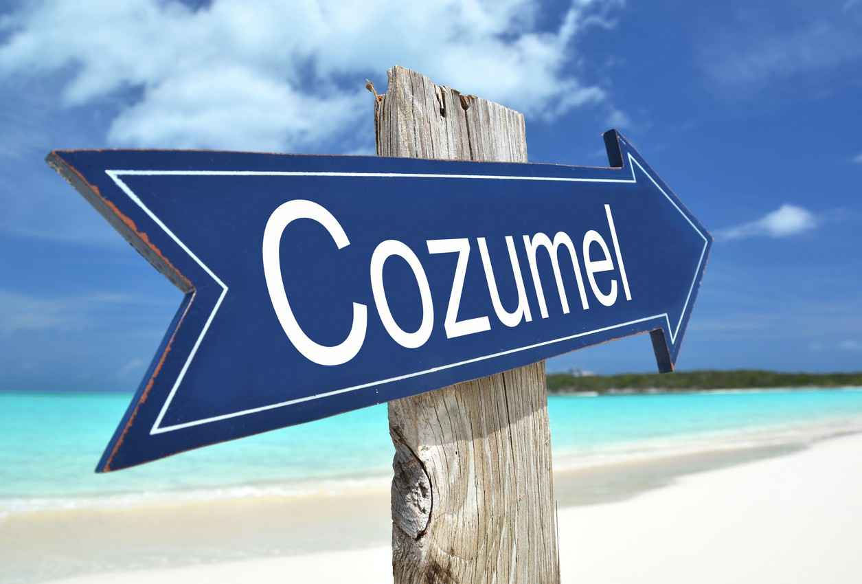 A Cozumel signpost near the beach.