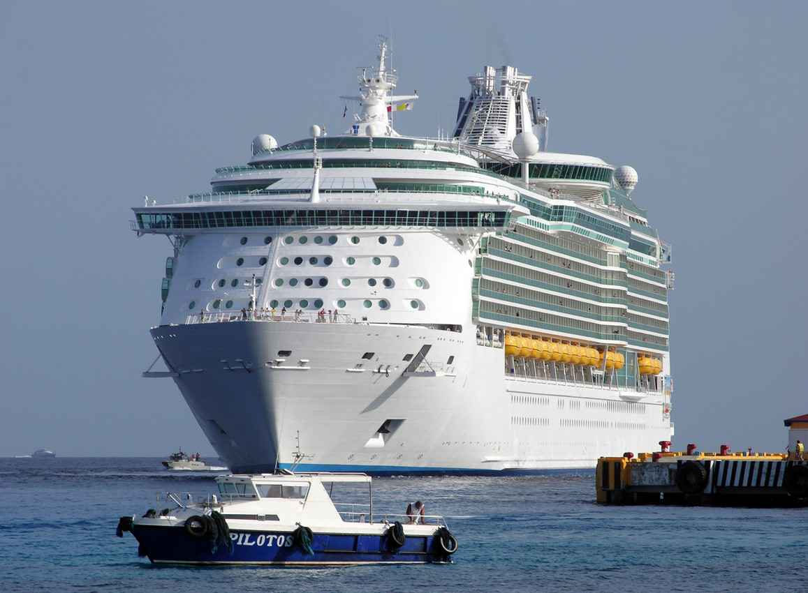 A cruise ship getting ready to dock.
