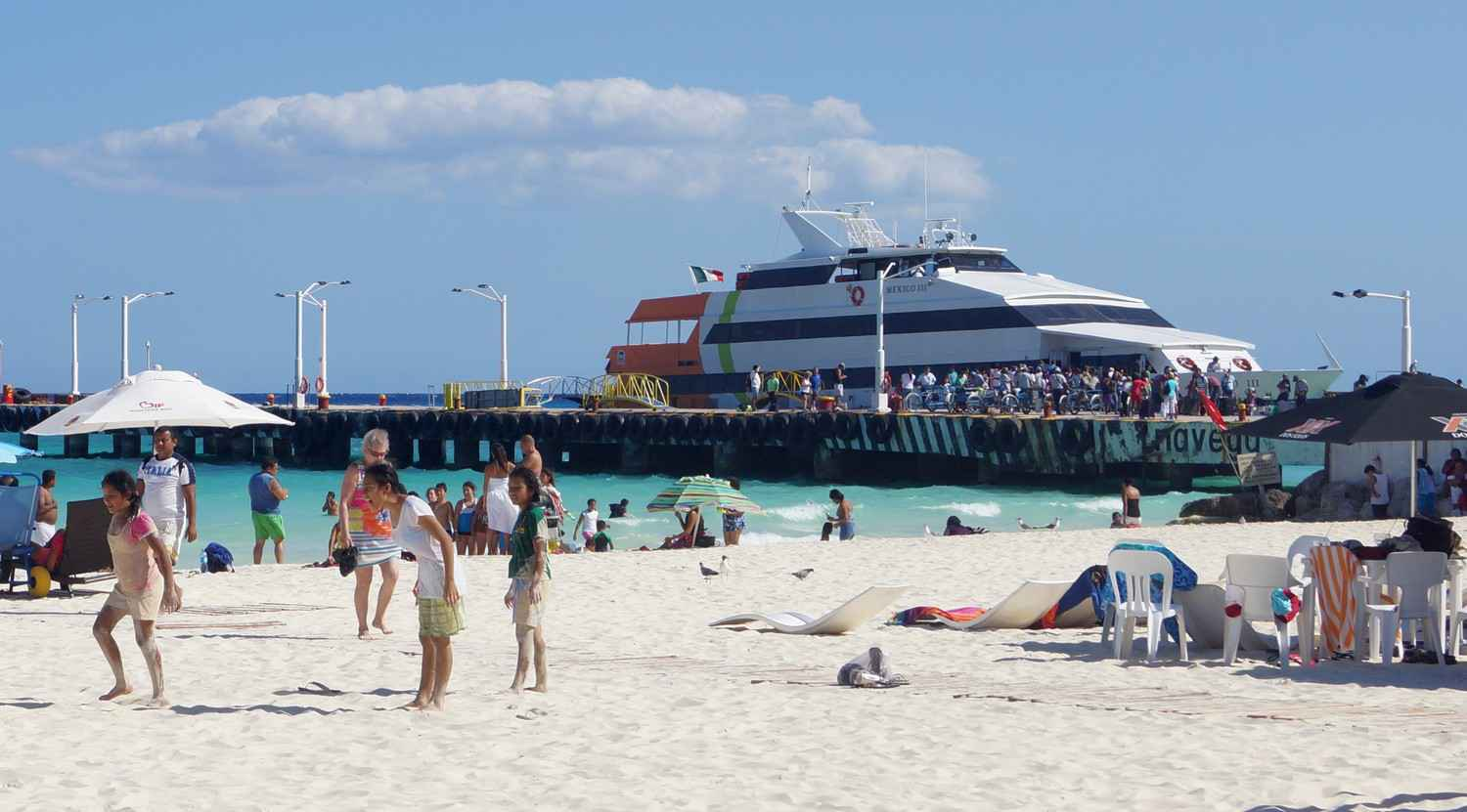 A ferry boat docked near the Playa Del Carmen beach.
