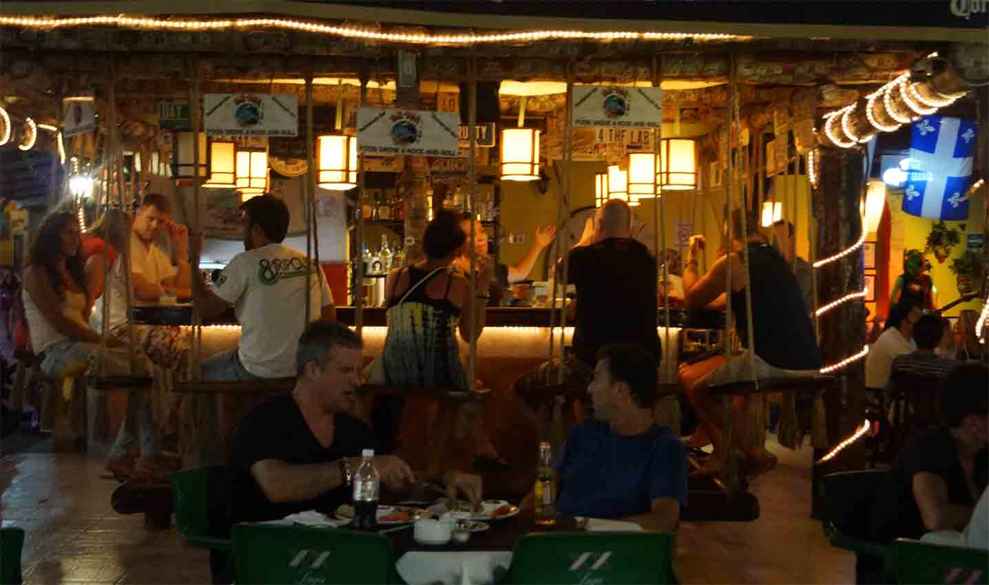 A popular bar with swings for seats in Playa Del Carmen.