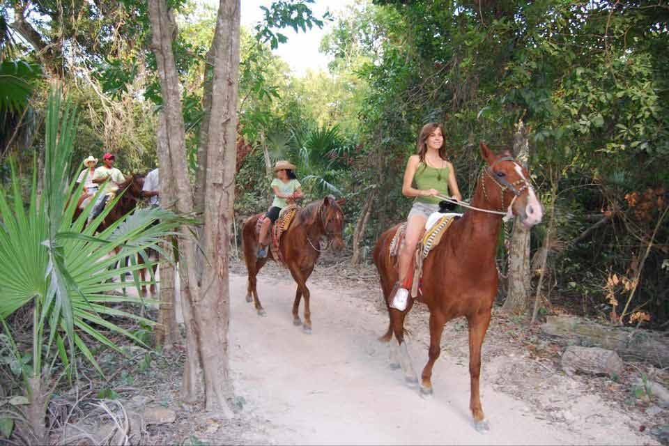 Hot chick leading a pack of horse riders in Playa Del Carmen