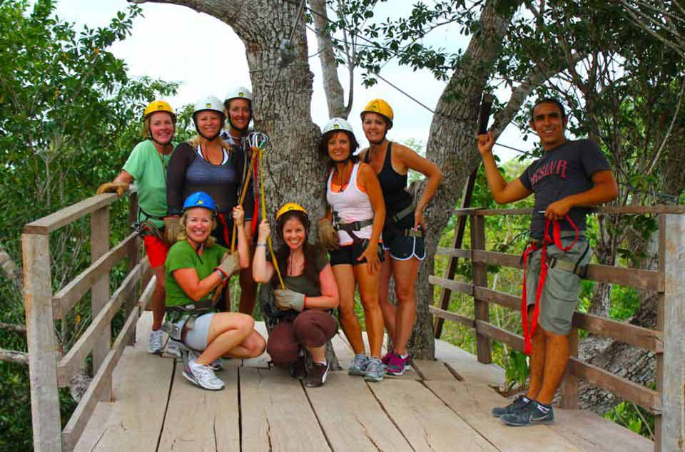 Seven women getting ready to go zipling during horse riding tour