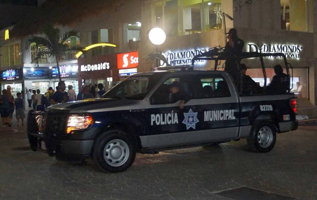 The municipal city police driving through downtown Playa Del Carmen.