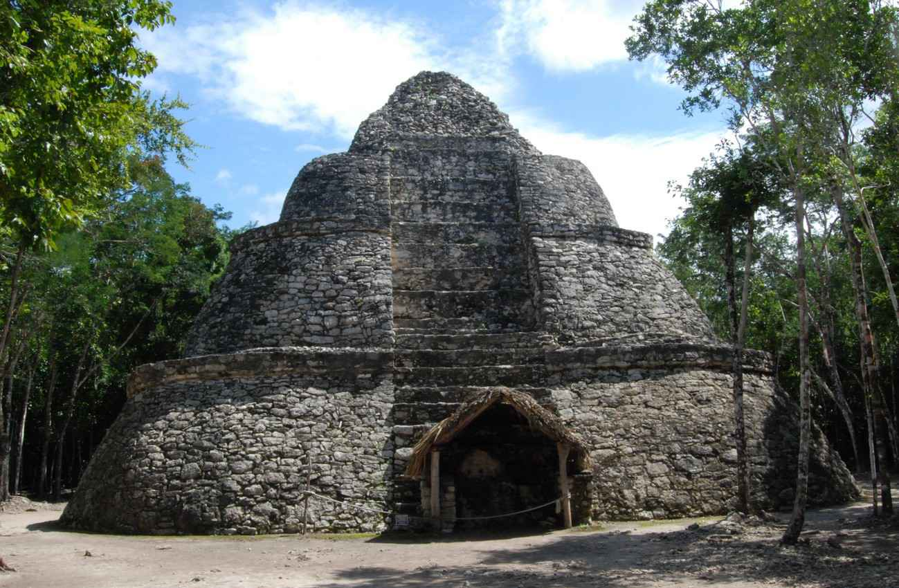 A midsized Mayan pyramid at an archaeological site.