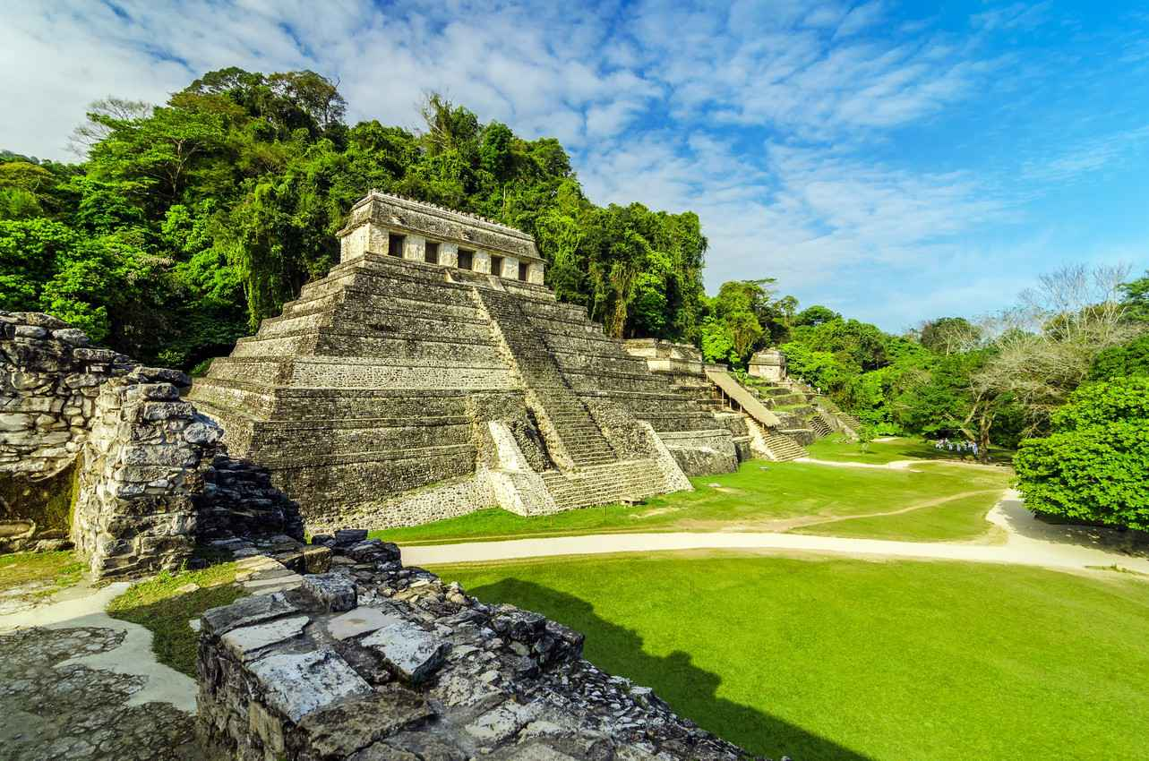 A beautifully maintained Mayan pyramid in the jungle.