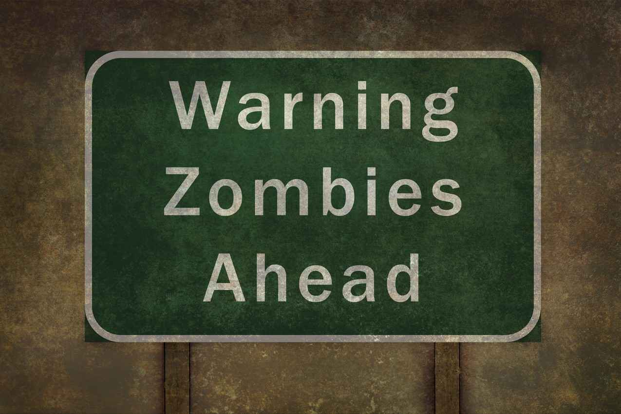 A street sign that reads, warning zombies ahead.