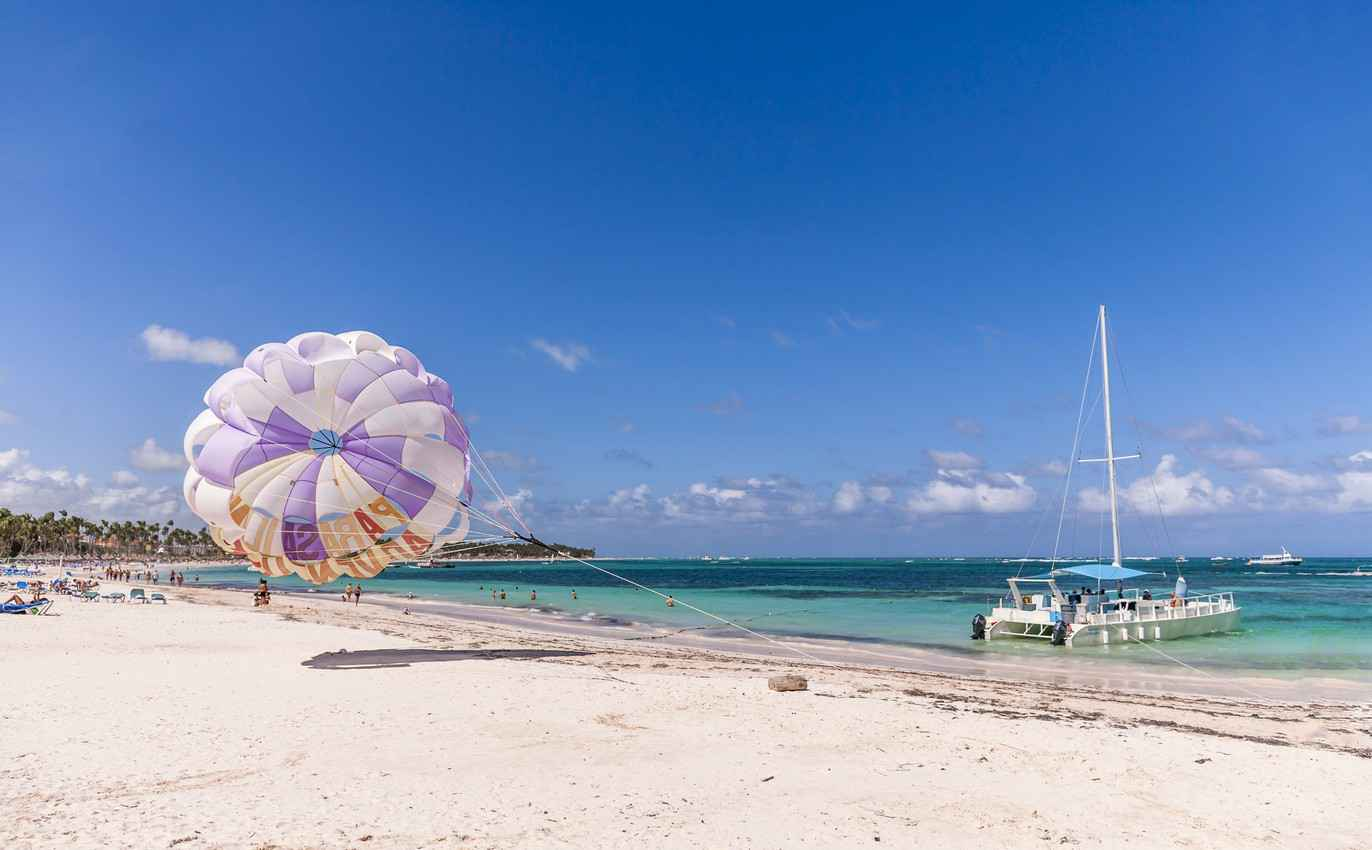 A parasail blowing in the wind on a beach in Playa Del Carmen.