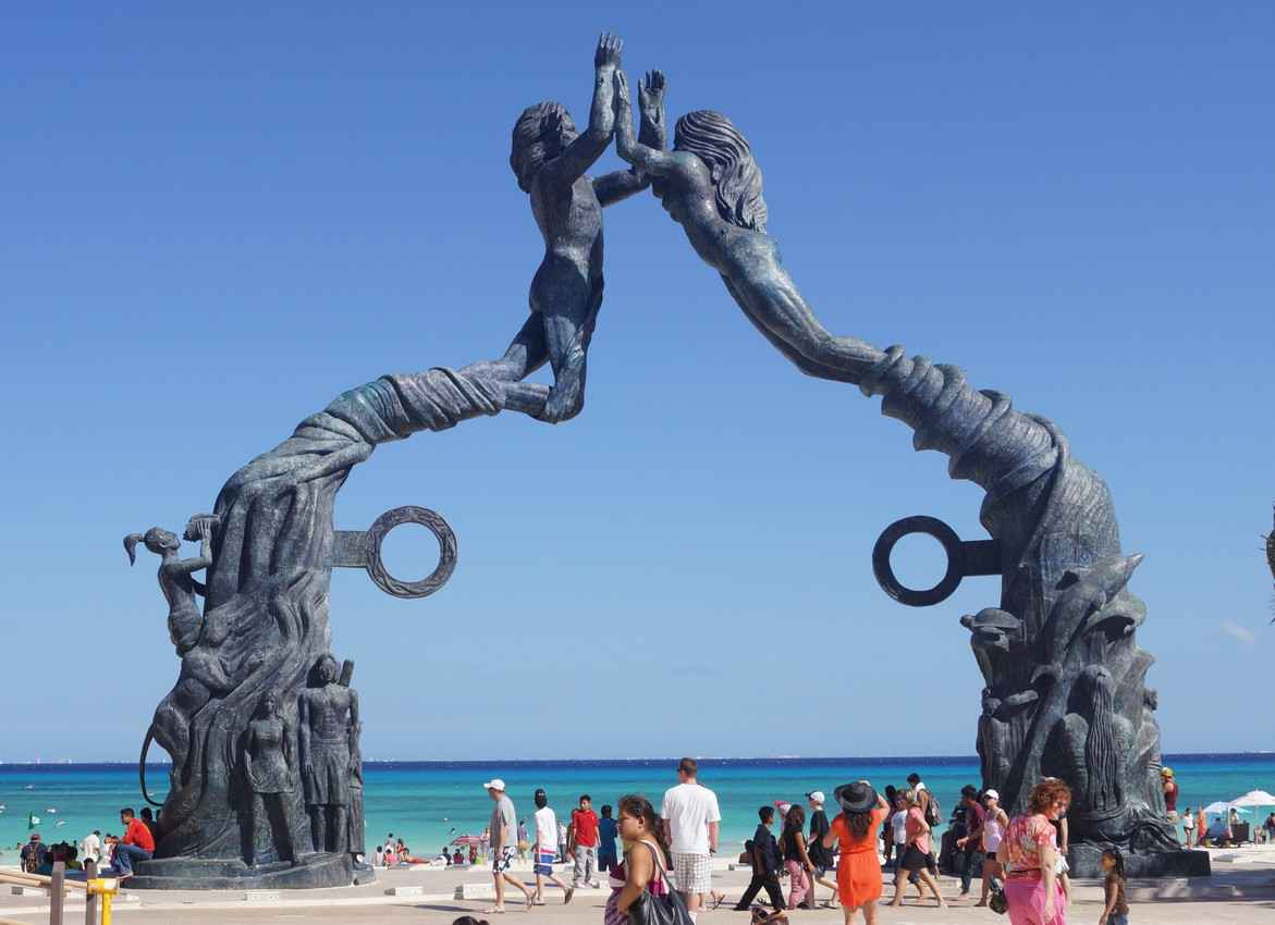 One view of the beautiful statue that overlooks the Playa Del Carmen beach.