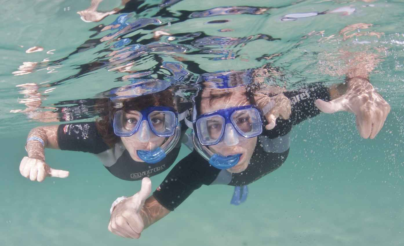 A man and woman snorkeling near Playa Del Carmen.