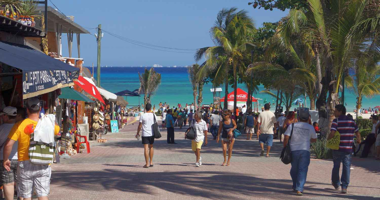 A view of the beach from Fifth Avenue Cozumel visible in the background.