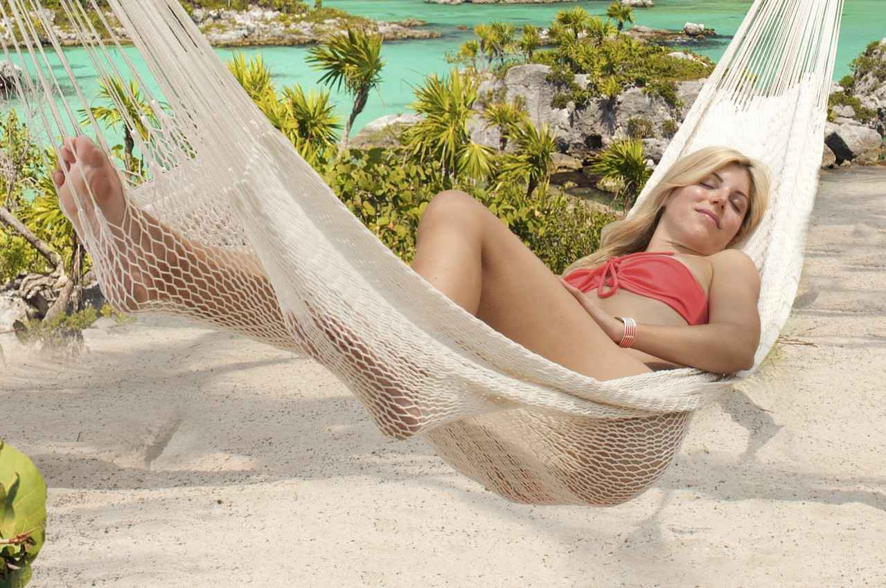 A woman in a hammock near Xel-ha beach.