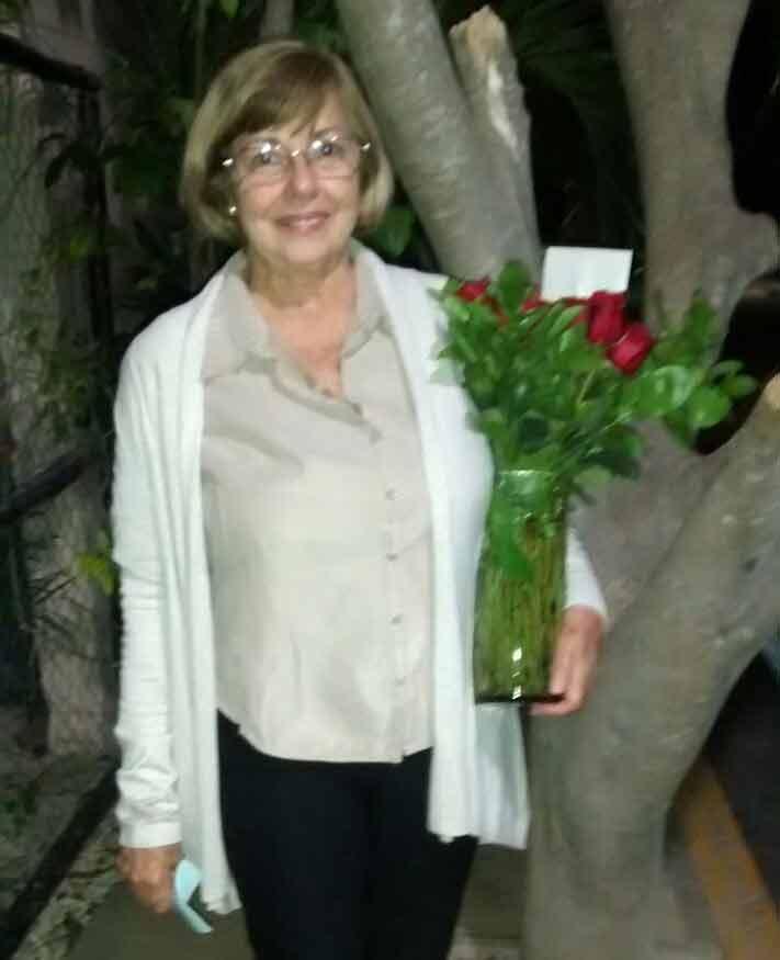 maricarmen-holding-a-vase-full-of-roses