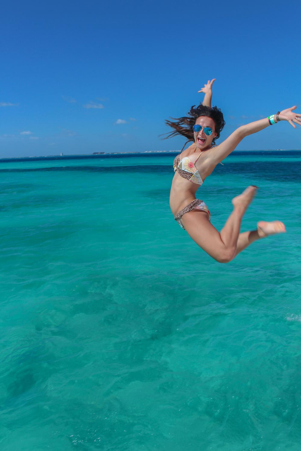 skinny-woman-jumping-off-the-deck-of-a-booze-cruise-boat