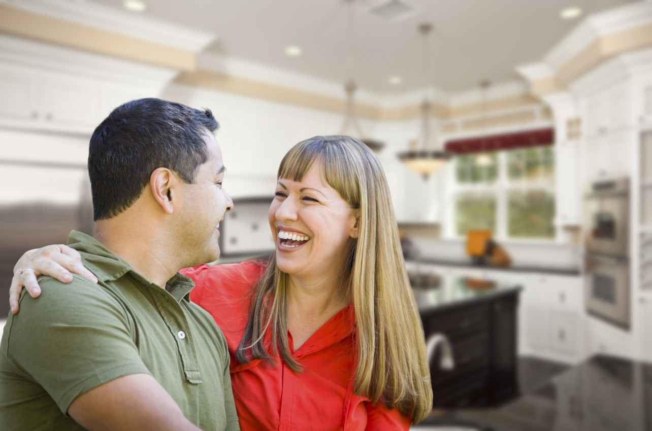 A man and a woman who appear to be extremely happy with their new property.