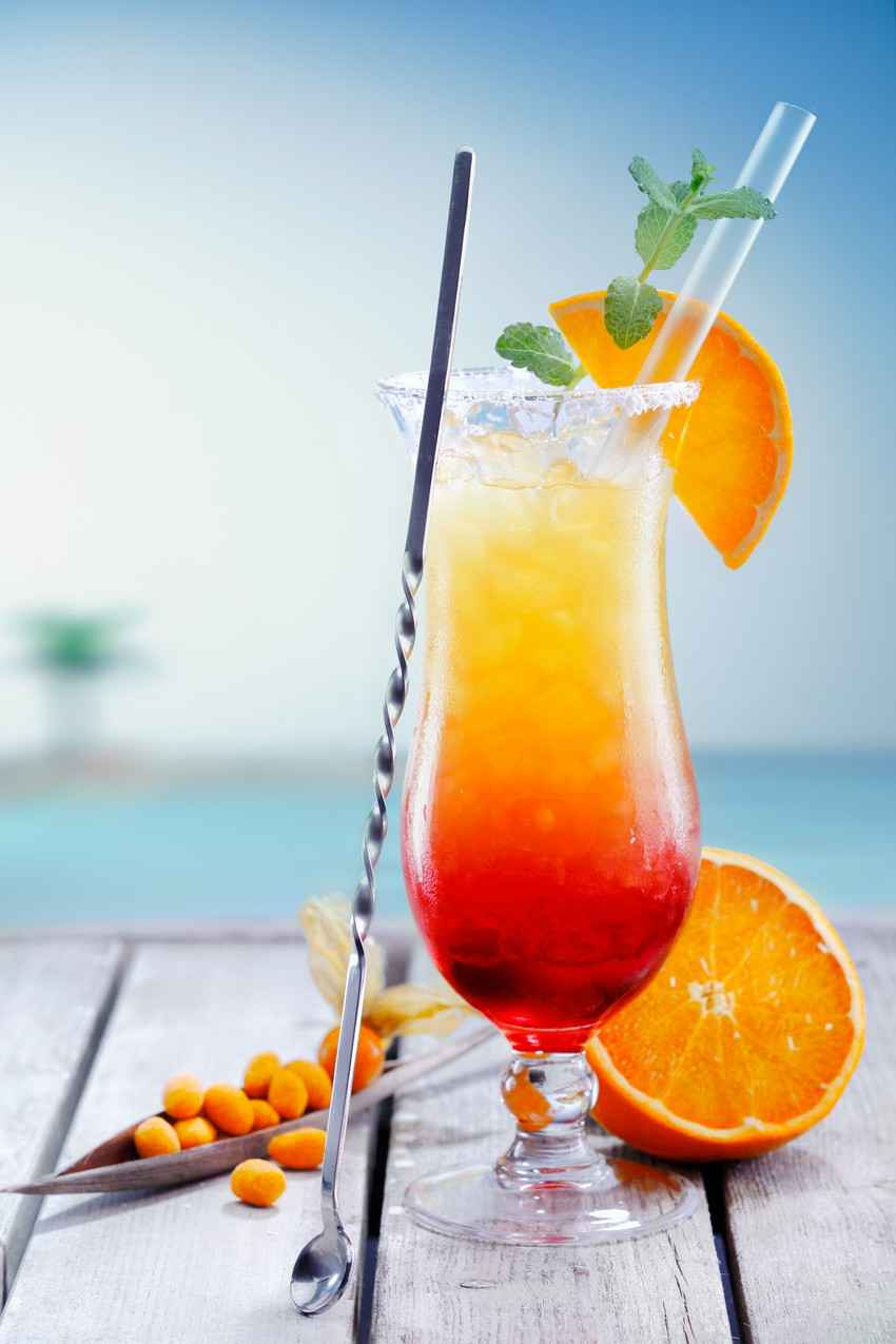 A delicious looking cocktail in front of the Caribbean Sea.