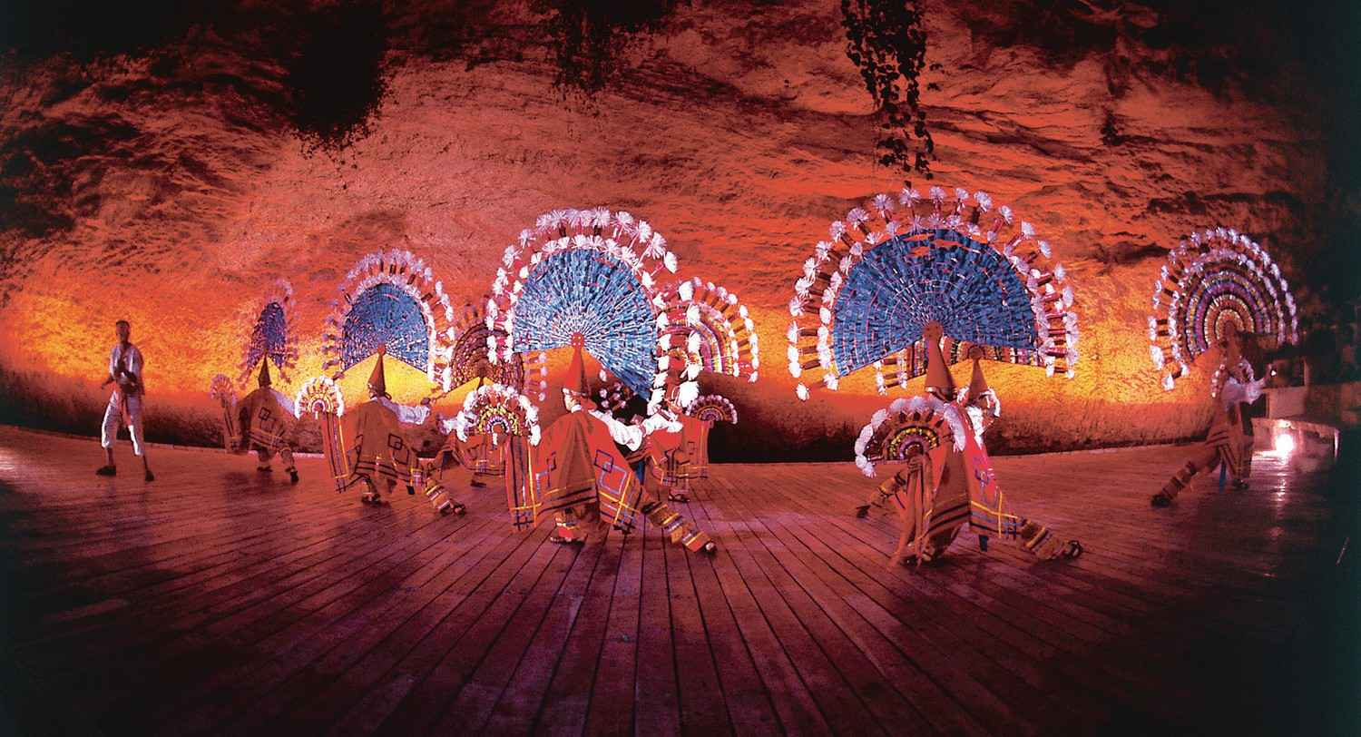 A group of Mayan dancers performing an ancient dance.