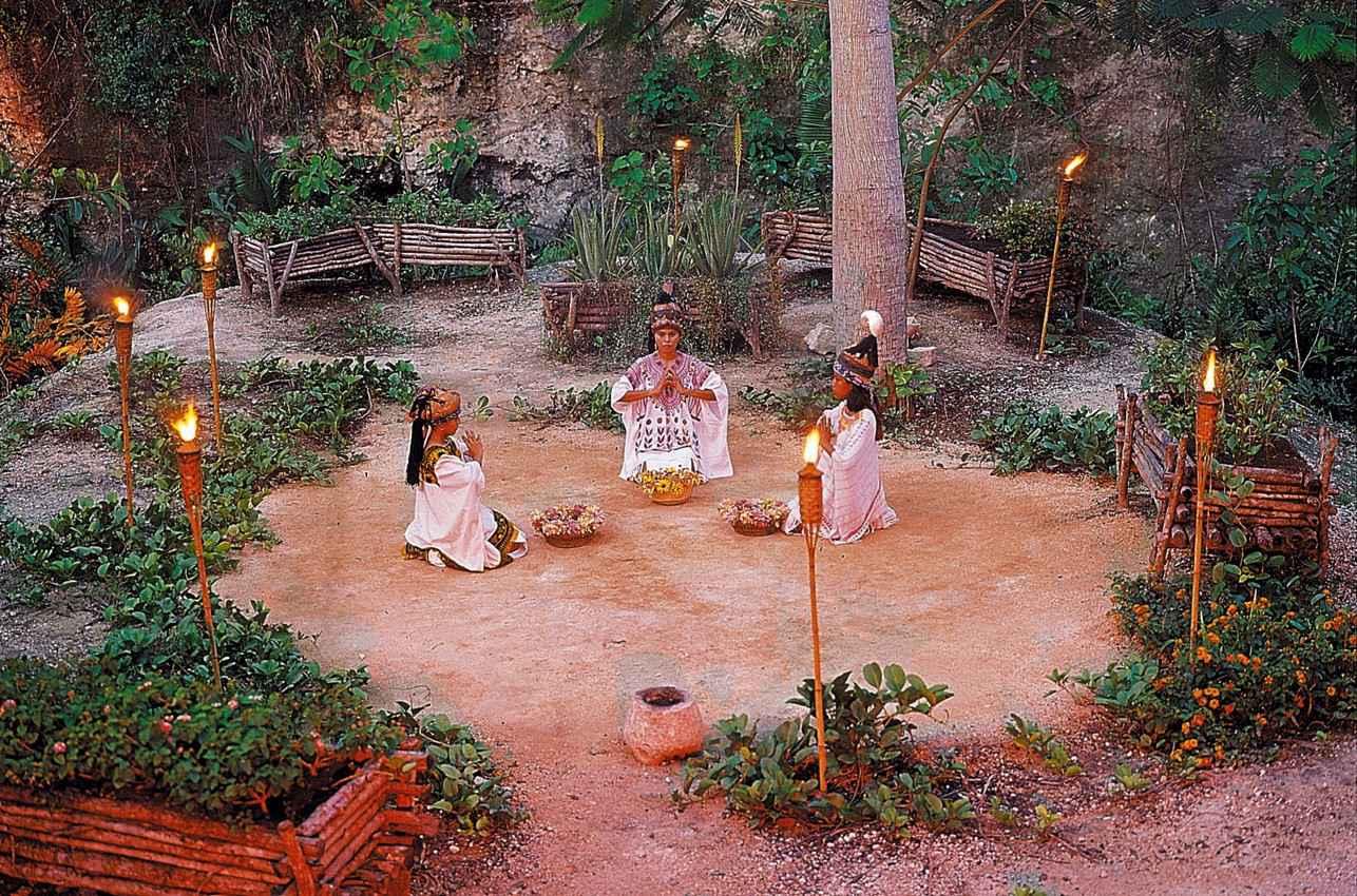 Men and women performing a reenactment of an ancient Mayan ritual.