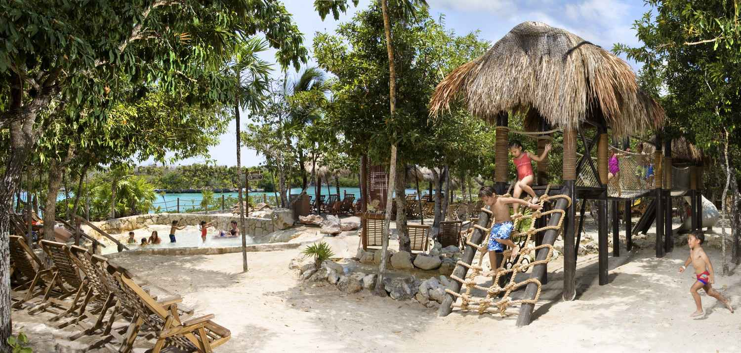 Several kids playing at the Xel-Ha themepark playground.