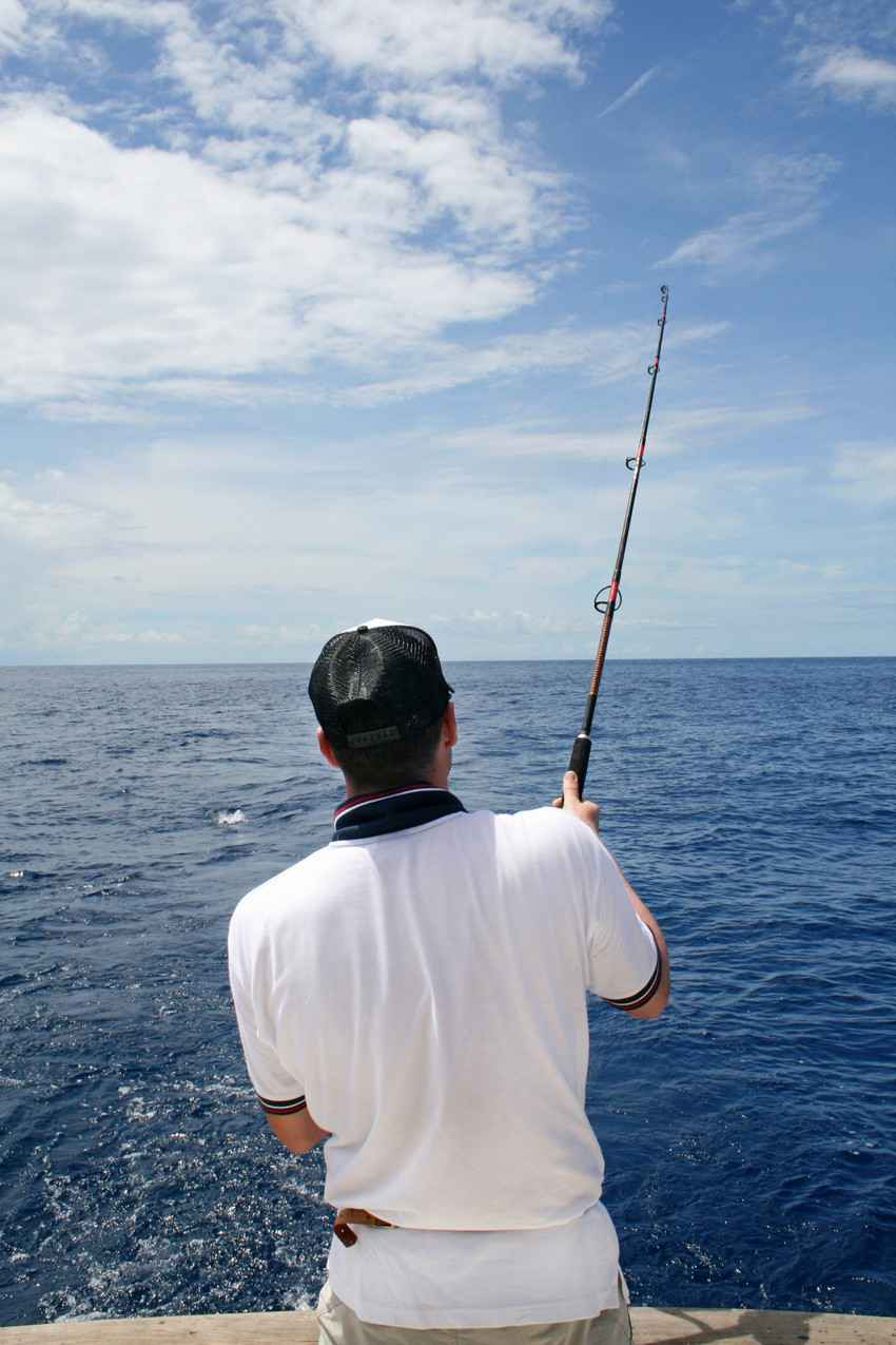 A man fishing on a Playa Del Carmen fishing expedition.