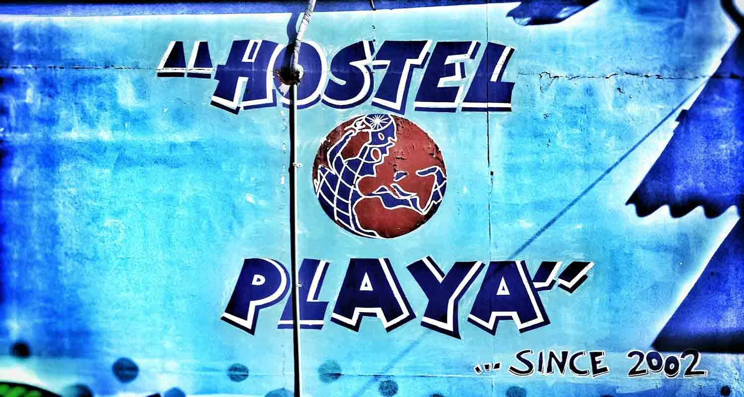 A painted logo on the wall of Hostel Playa