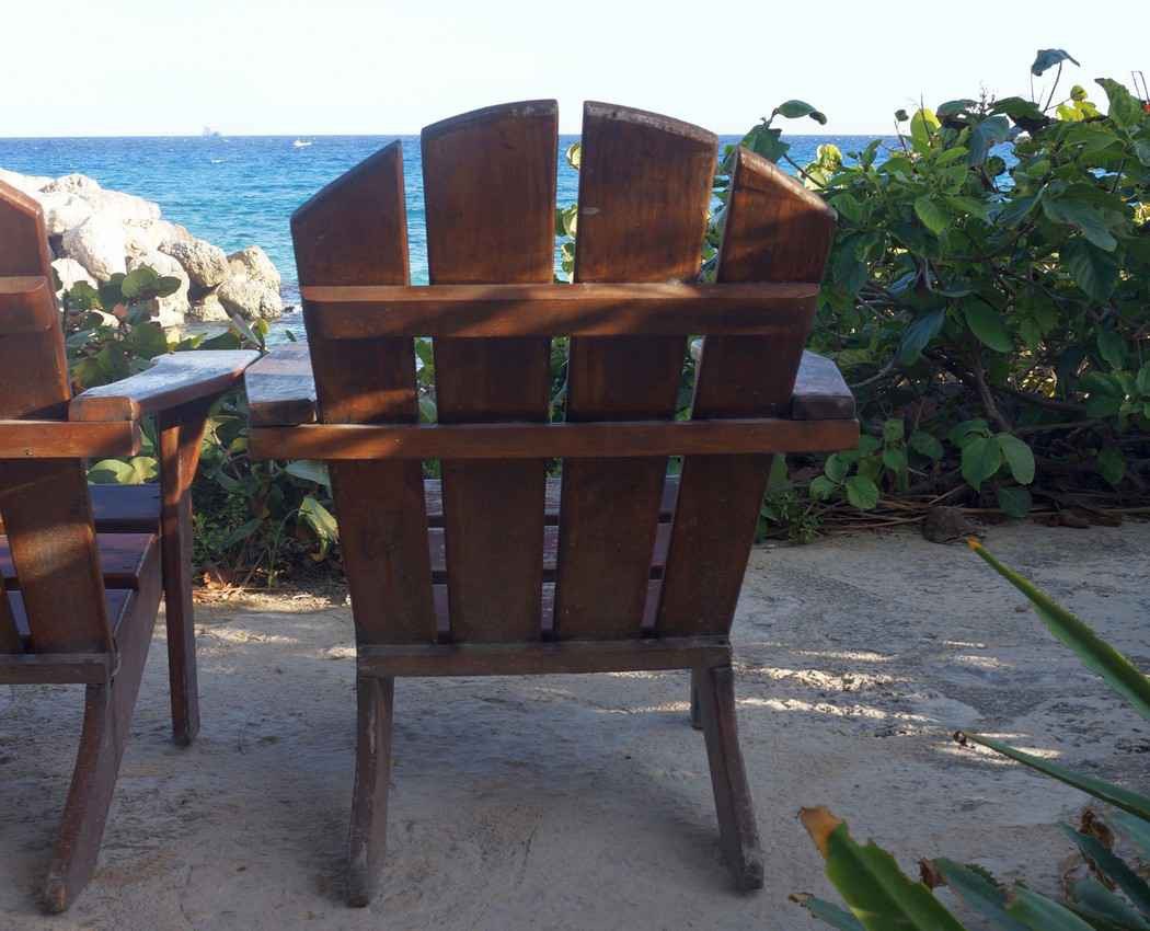 A wooden chair at a hotel near the beach.