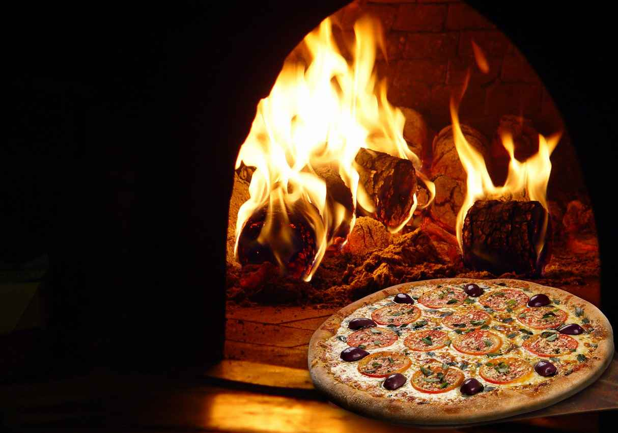 An Italian pizza cooked at a restaurant in an authentic brick oven.