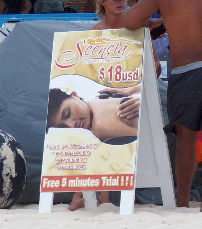 A tent-style massage advertisement on the beach in Playa Del Carmen.
