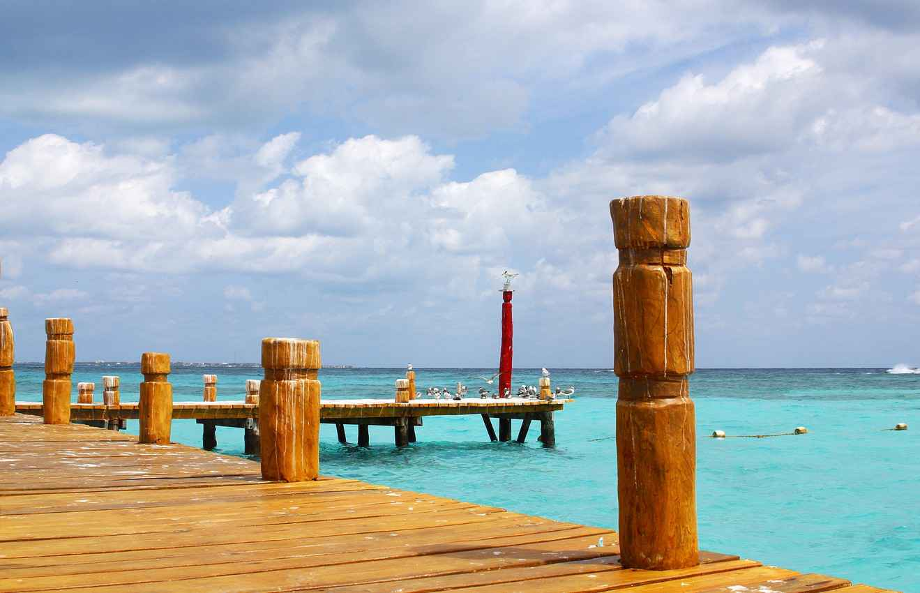 A wooden dock near the beach.