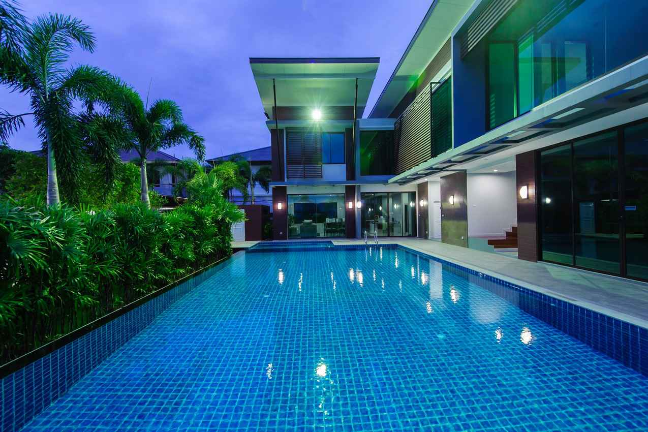 A large and expensive rental home with a shallow swimming pool.