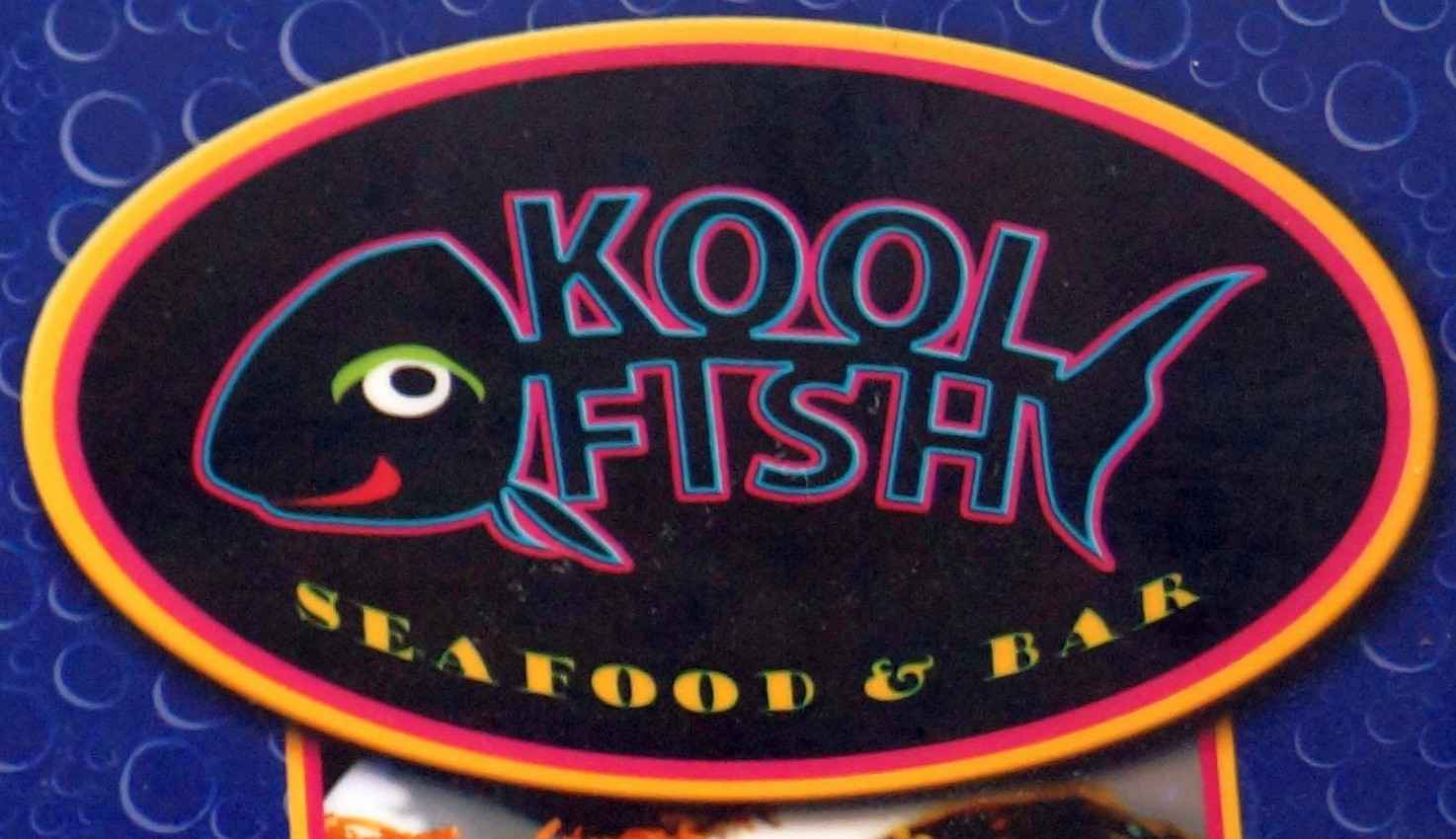 The Kool Fish logo above the door of the restaurant.