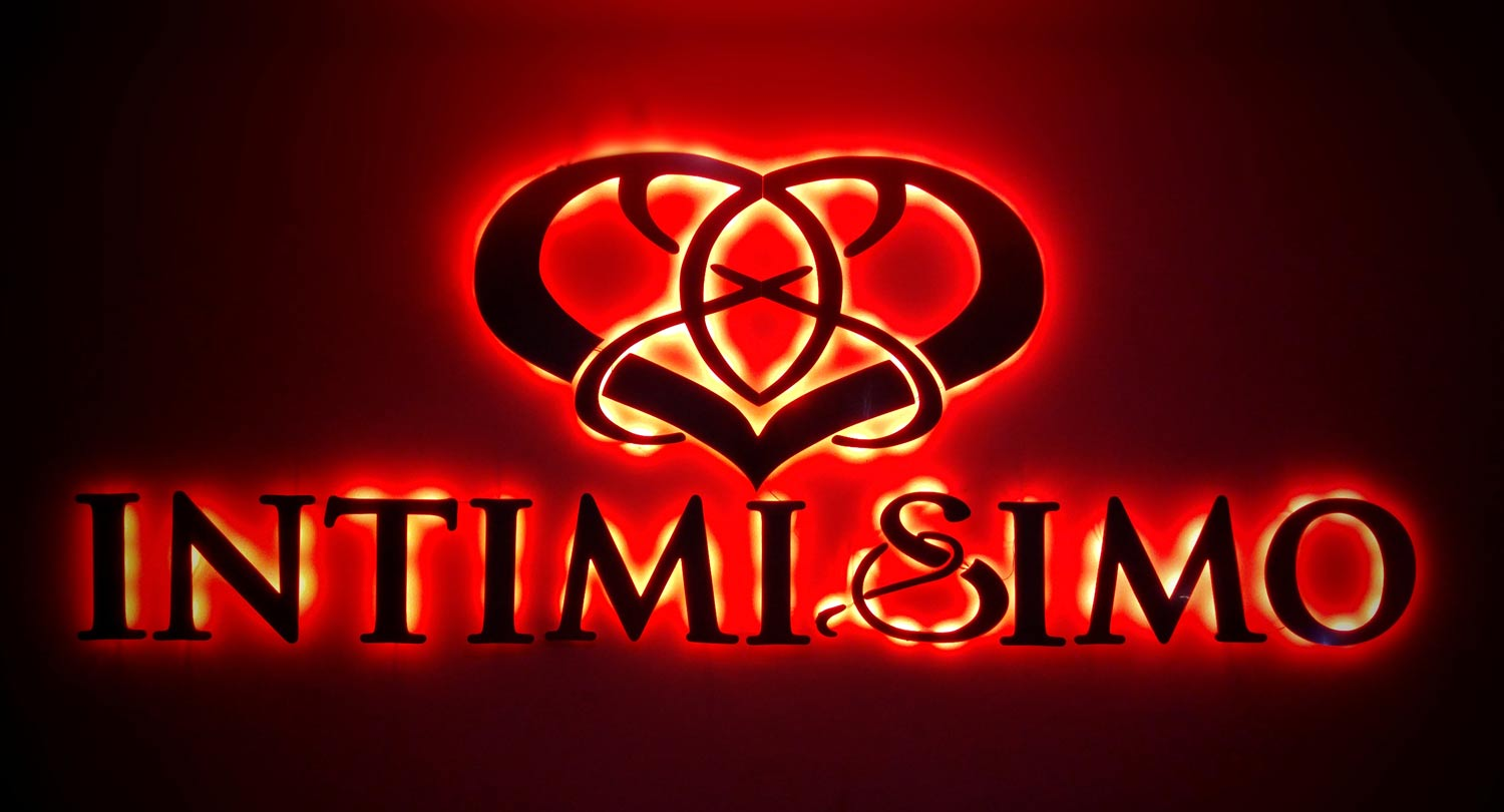 The Intimisimo Hotel logo on a wall in Playa Del Carmen.