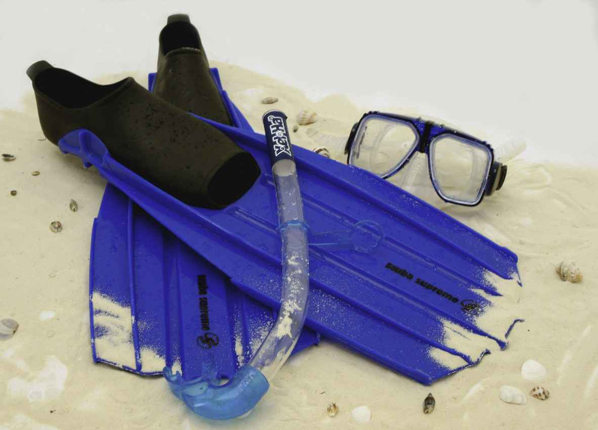 A snorkeling mask and a pair of fins that are used at the Xel-Ha natural aquarium.