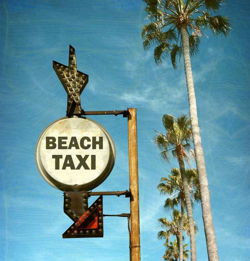 A beach taxi sign in Playa Del Carmen.