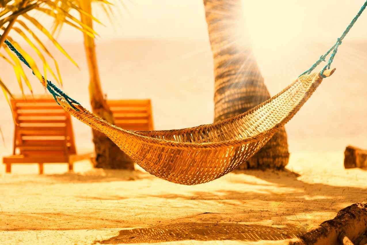 A handwoven hammock on a Playa Del Carmen beach.