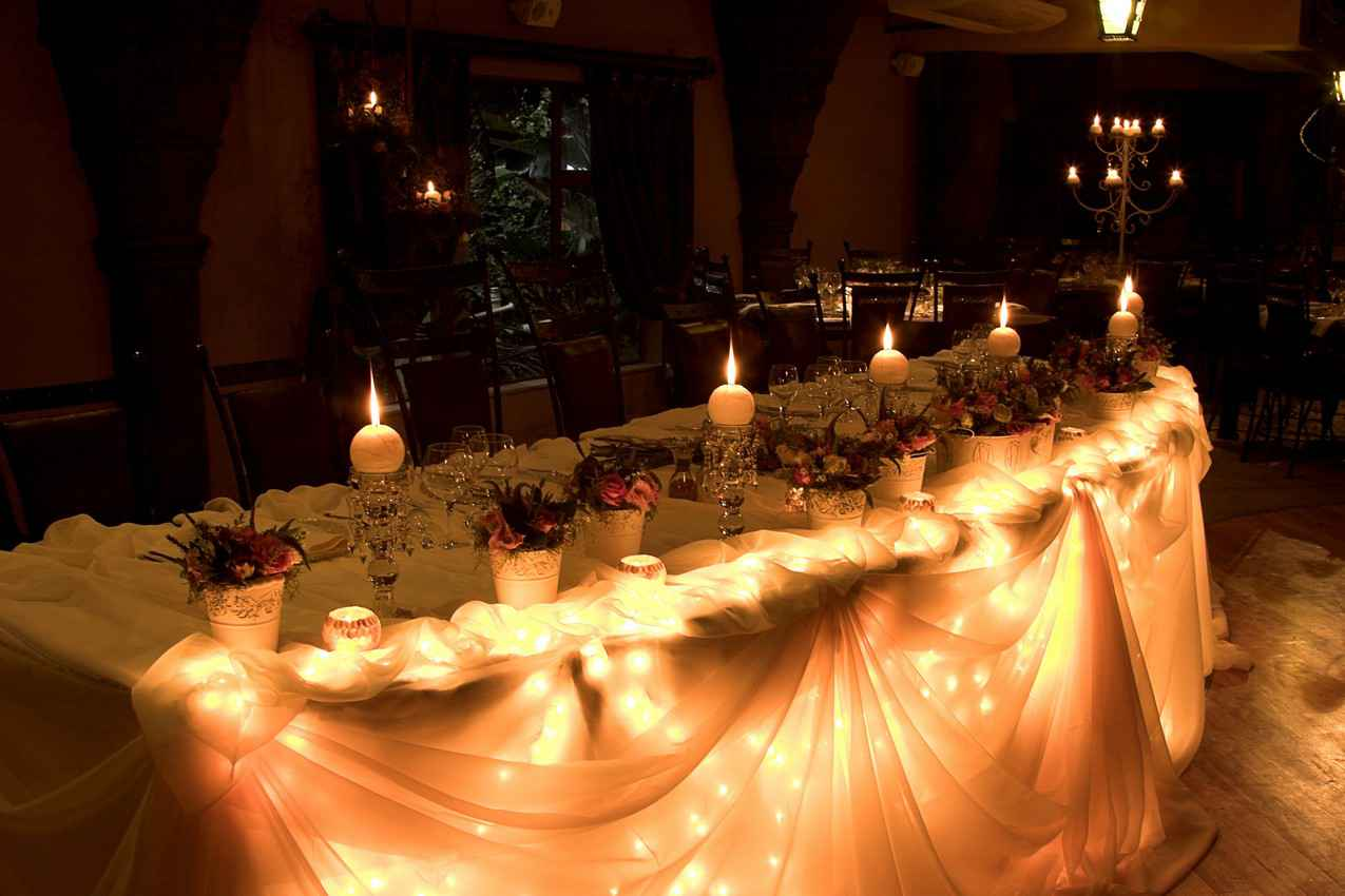 A brightly lit wedding party table at a Playa Del Carmen resort.