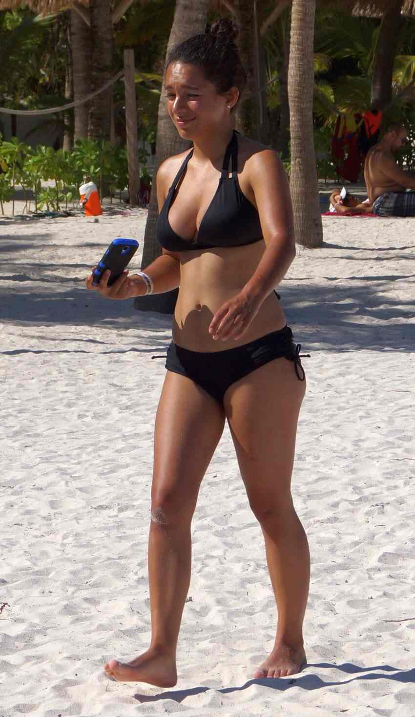 A hot Mexican babe who was walking along the beach in Akumal.