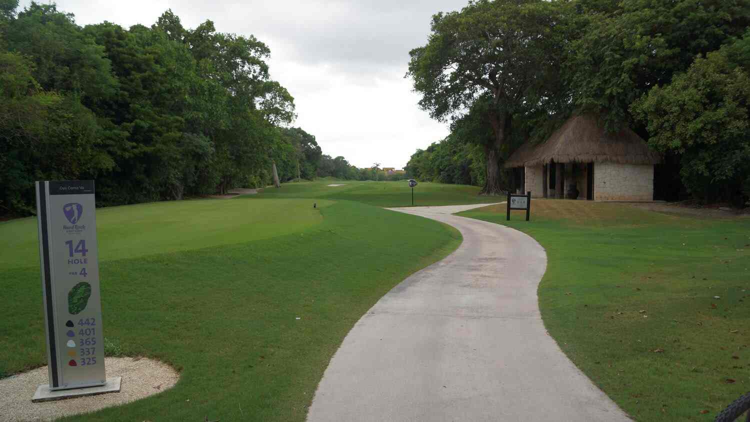 A walking path running along a the Hard Rock golf course in Playacar.