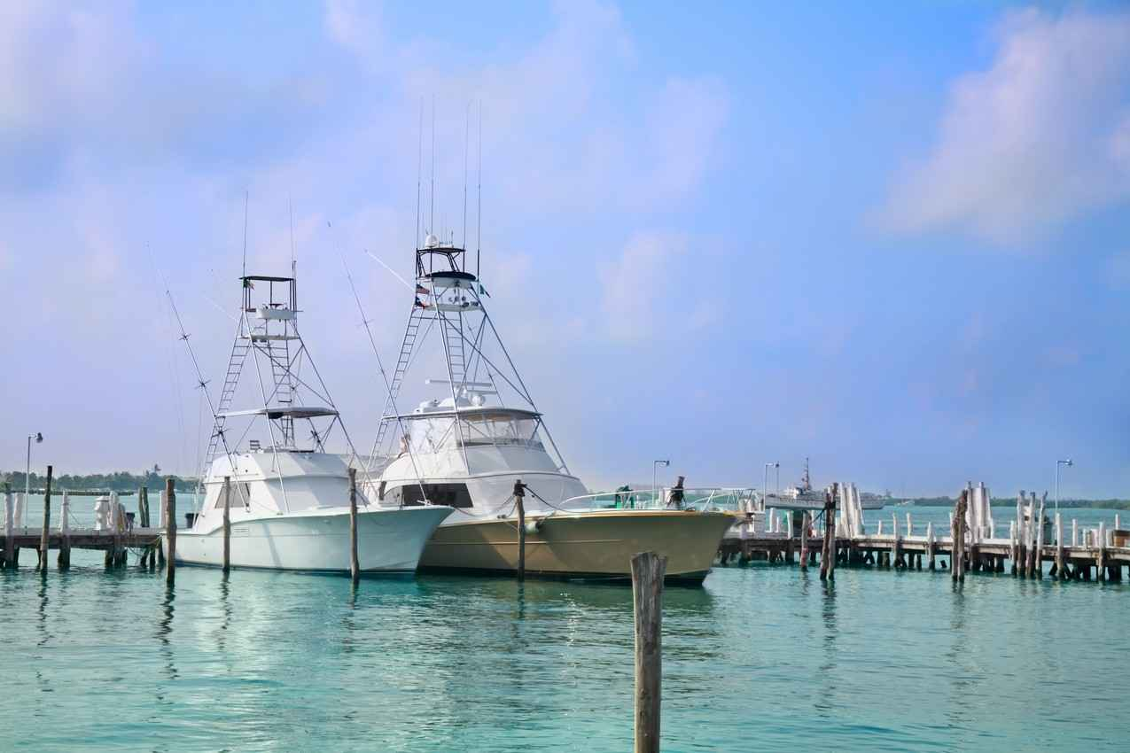 Two large fishing boats in a local marina.