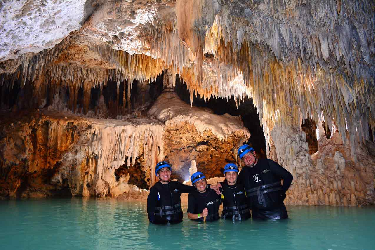 3-rio-secreto-participants-and-guide-standing-in-water-at-rio-secreto-reserve-park-in-playa-del-carmen