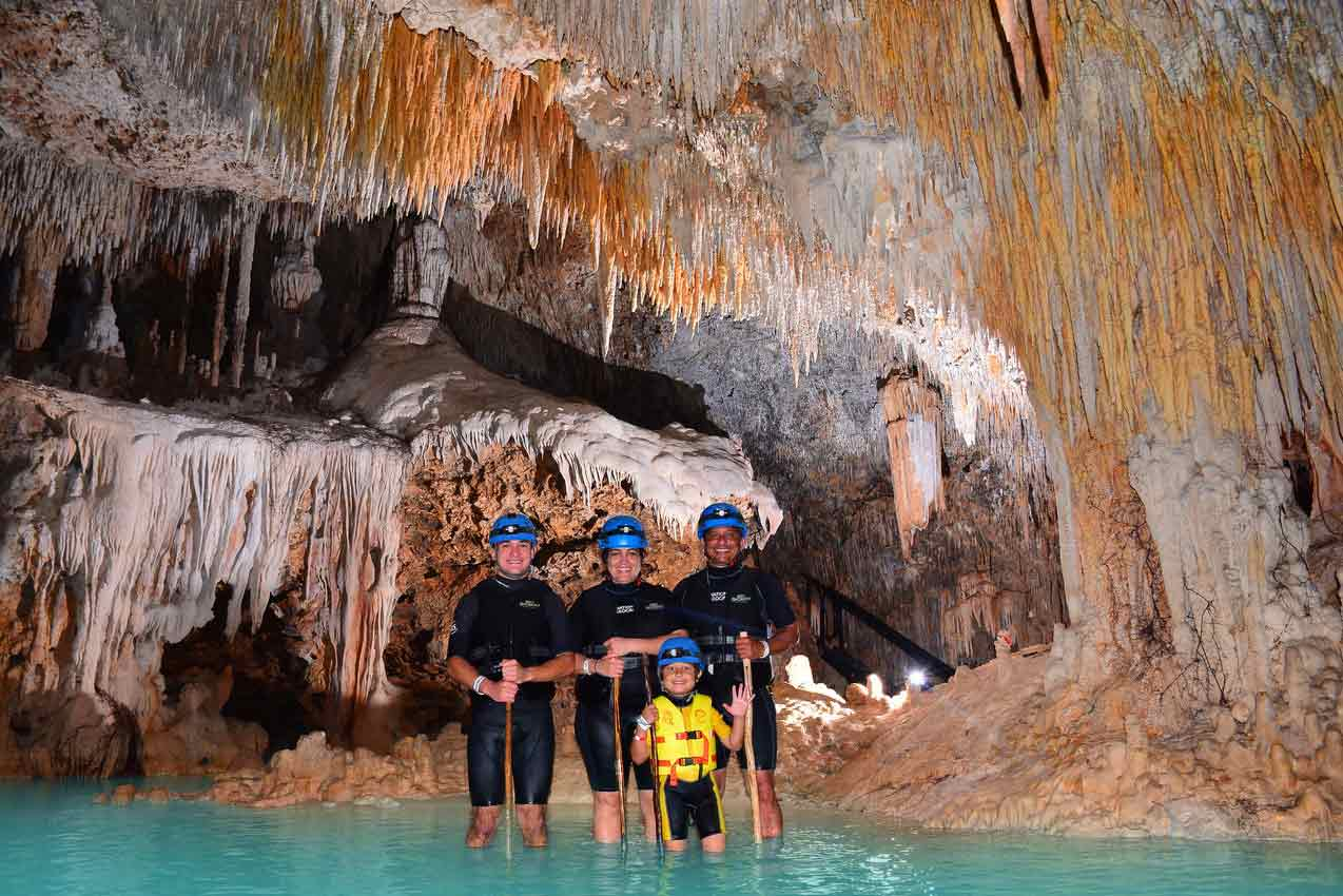 guide-man-woman-child-participating-in-rio-secreto-playa-del-carmen-tour