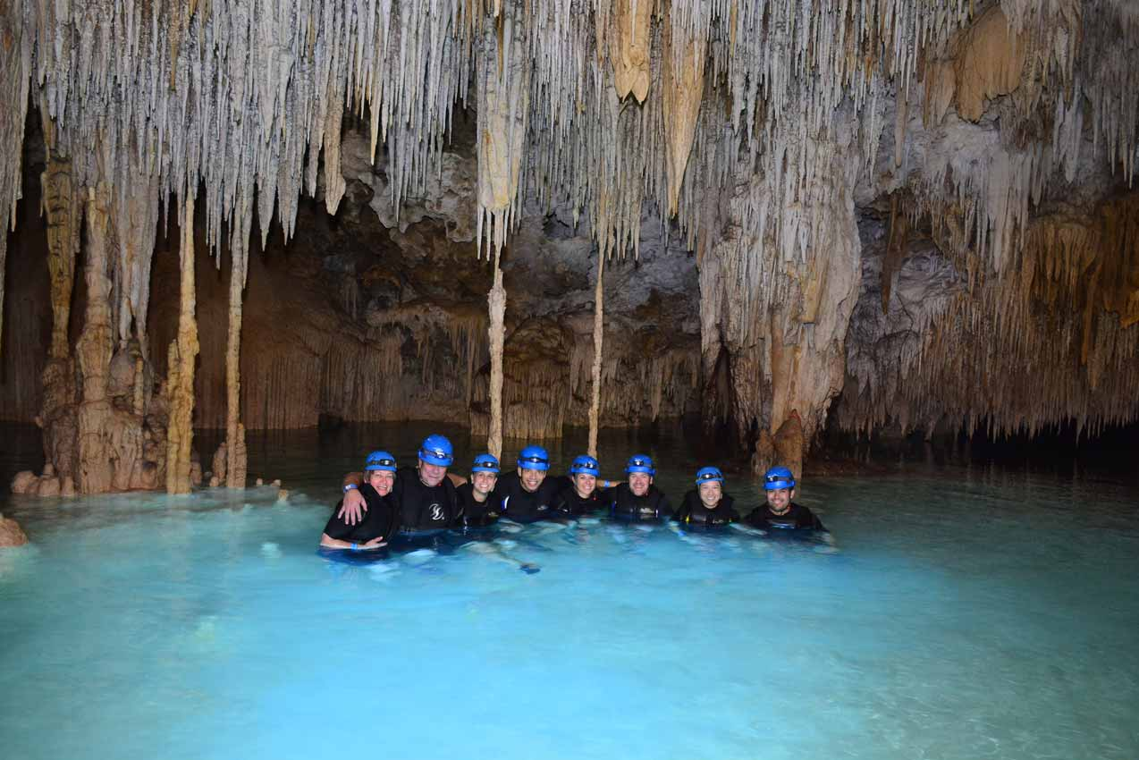 rio-secreto-tour-group-of-8-people-and-guide-with-stalactites-and-stalagmites-overhead