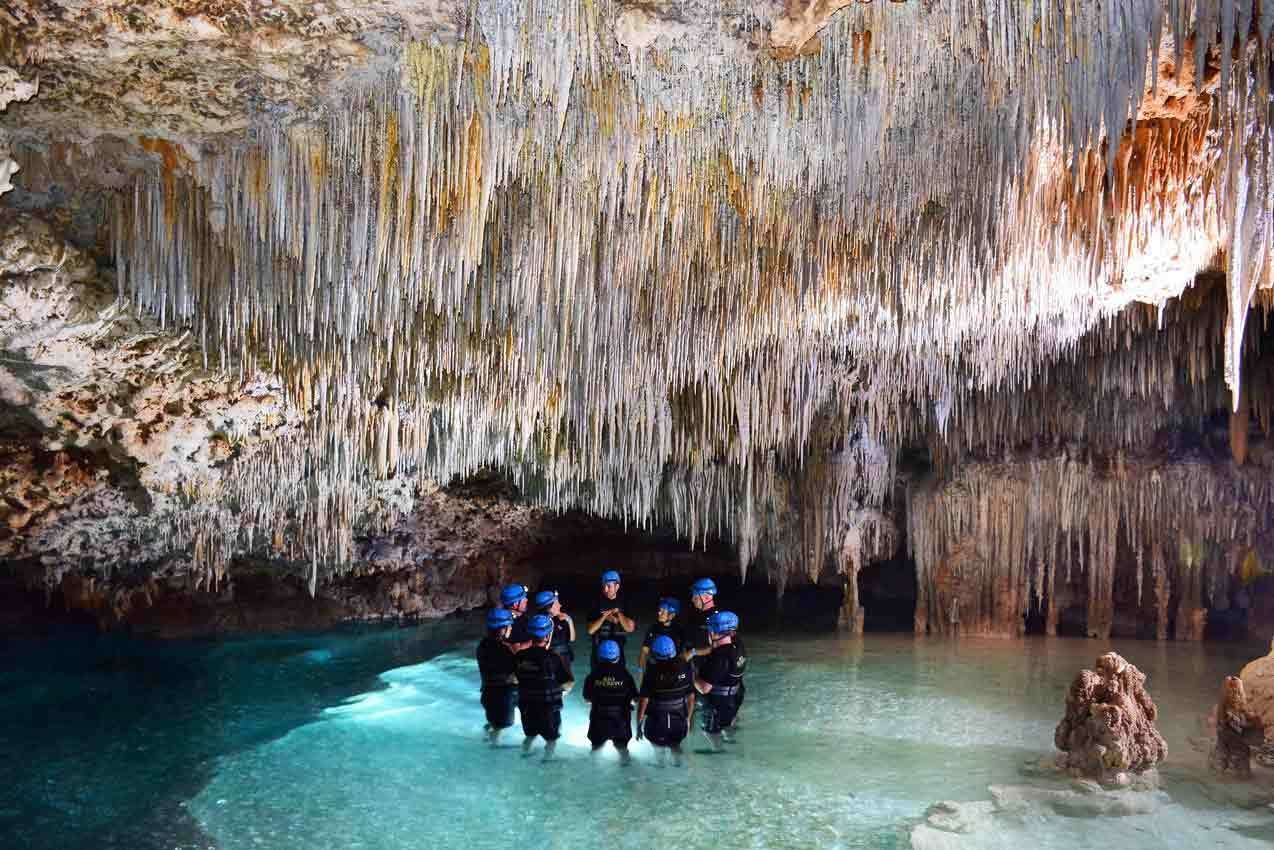 rio-secreto-tour-guide-and-group-have-discussion-in-large-cave-near-playa-del-carmen