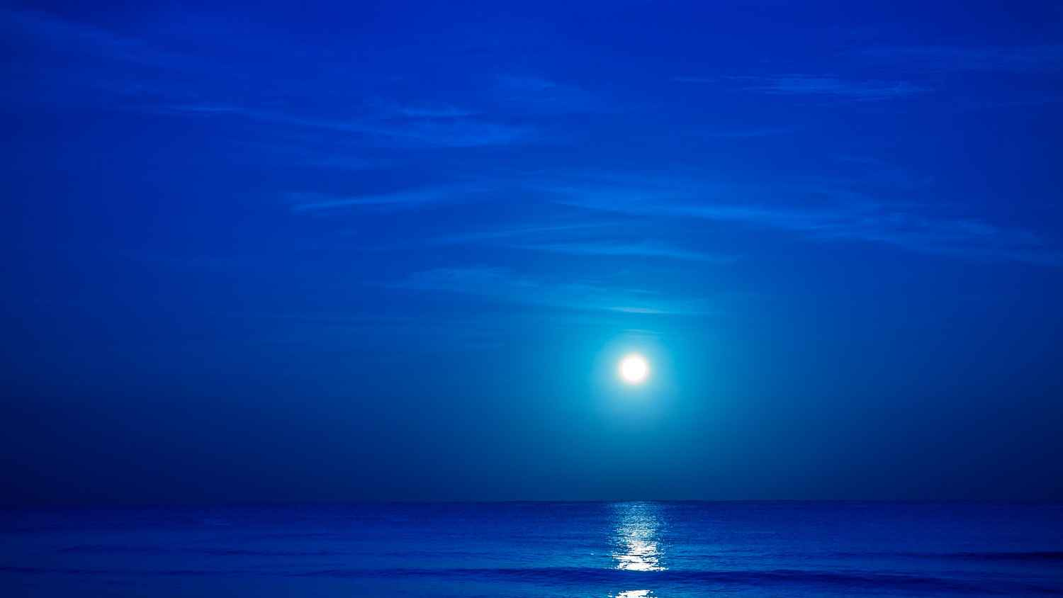 The beautiful moonlight reflecting off of the ocean near the Playa Del Carmen beach.