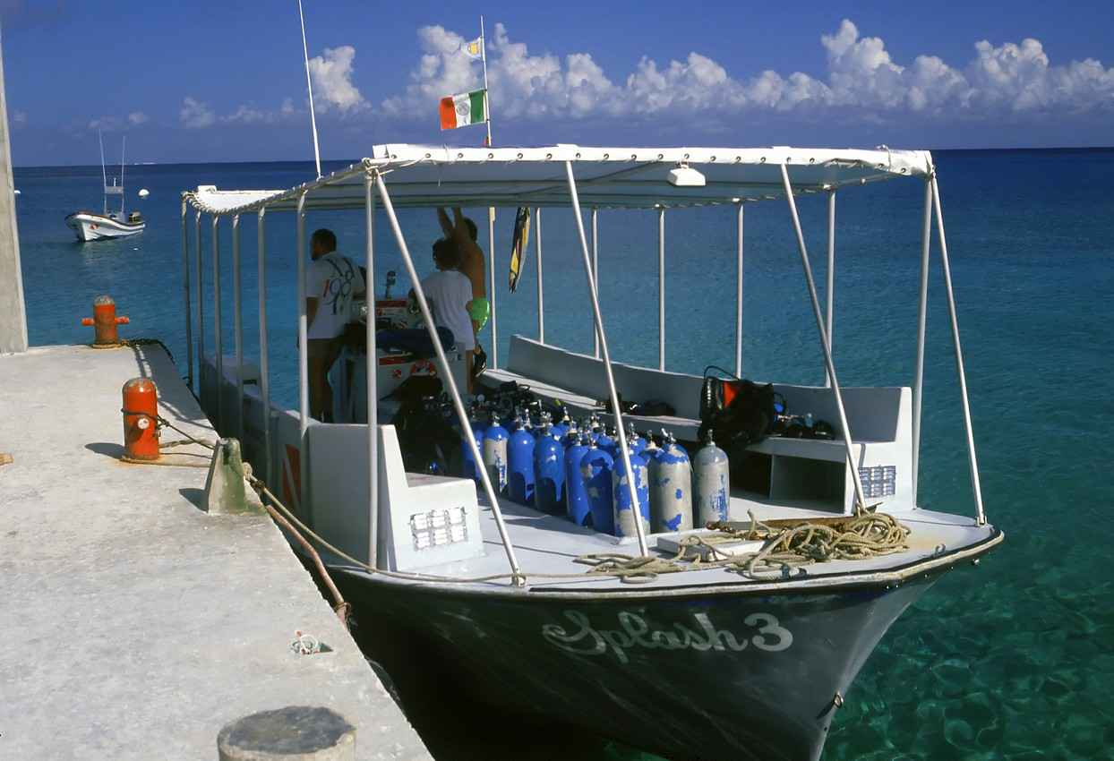 A scuba diving boat anchored at a dock in Playa Del Carmen.