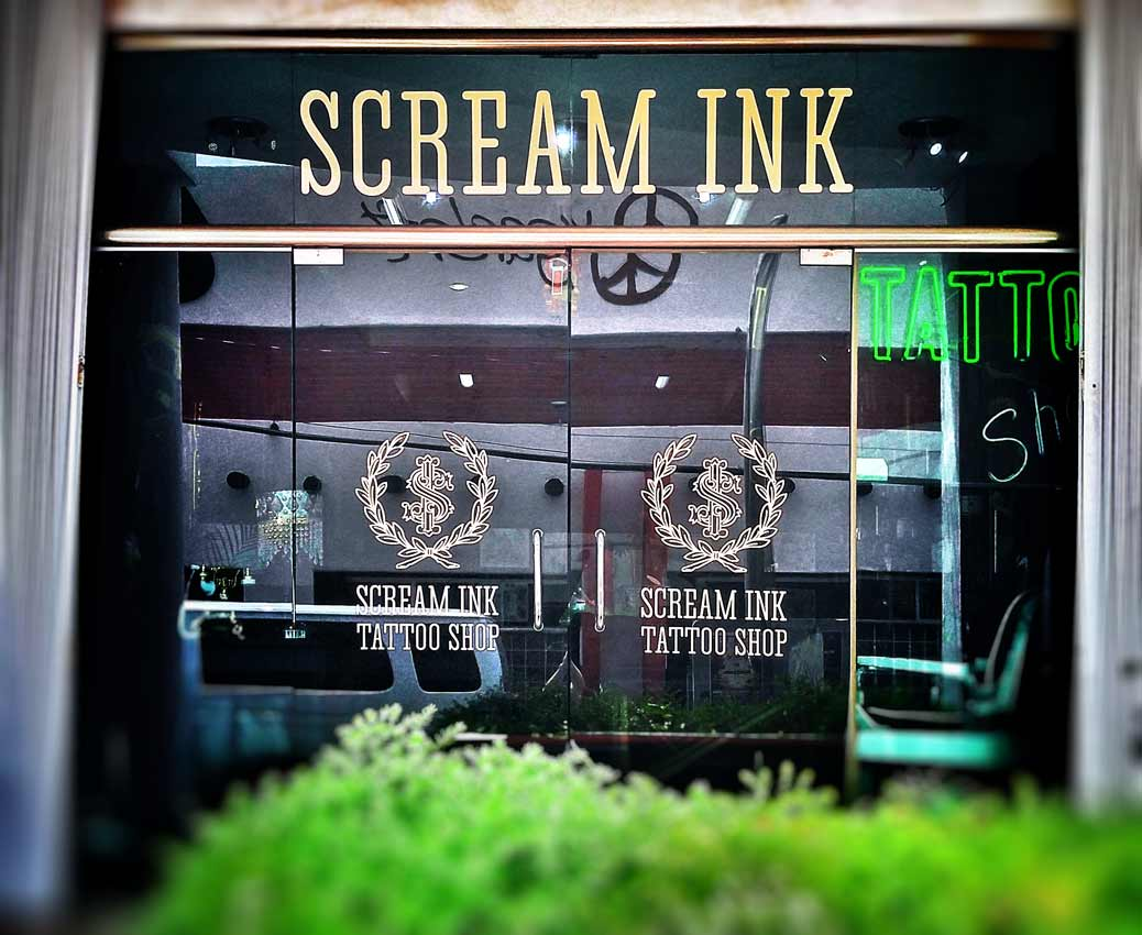 A picture of the front door of Scream Ink Tattoo Shop in Playa Del Carmen.